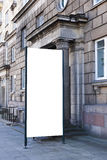 Mock up. Blank outdoor advertising column outdoors, public information board in the street. Stock Image
