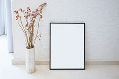 Mock up Blank photo frame on floor Home interior decoration Stock Images
