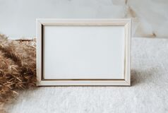 Free Mock Up Blank Photo Frame On Table. Gray Linen Tablecloth Fabric Background. Home Office Decor. With Copy Space. Royalty Free Stock Photos - 221583218