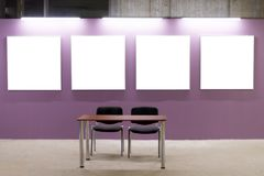 Mock up. Blank picture frames on pink wall in the loft interior. Gallery wall with empty poster frames indoor. Stock Photos