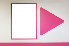 Mock up blank poster frame with pink frames hanging on wall in shopping mill. Mock up blank advertising poster frame with pink frames hanging on wall in shopping Stock Photo