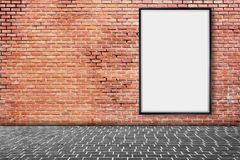 Mock up blank poster picture frame on brick wall. Mock up blank poster picture frame on red brick wall Royalty Free Stock Photo