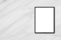 Mock up blank poster picture frame hanging on white marble wall in room. Stock Photos