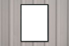 Mock up blank poster picture frame on wood wall. Royalty Free Stock Images