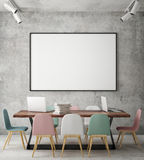 Mock up blank poster on the wall of hipster meeting room, Stock Image