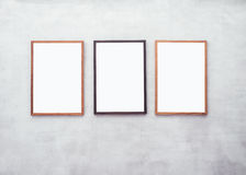 Mock up Blank Posters with Wooden frame on Cement wall Stock Photos
