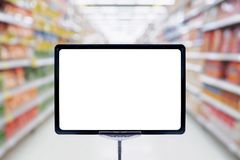 Mock up blank price board poster sign display. With supermarket aisle abstract background Stock Images