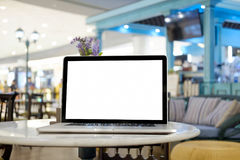 Mock up Blank screen of Laptop on marble table. In Co-working or cafe Royalty Free Stock Photography