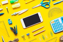 Mock up blank screen mobile phone for back to school background concept. School items background with copy space, top view flat royalty free stock photo