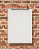 Mock up blank white hanging poster on brick wall, background Stock Images