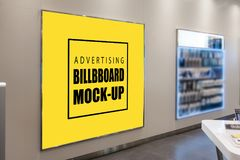 Mock up blank yellow advertising billboard in metal frame. With clipping path placed on wall in shopping store, nearly vending coin, perspective empty space for royalty free stock photos