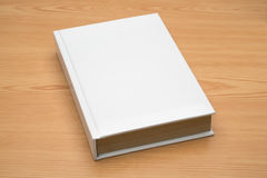 Mock up book on wood background Royalty Free Stock Photos