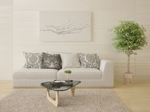 Mock up a bright living room with a compact sofa. Mock up a bright living room with a compact sofa and a stylish coffee table Royalty Free Stock Images