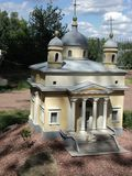 Mock-up of the building of the Alexandrovsky church at the exhibition of cues in miniature. City park summer open air mock-up of the building of the royalty free stock images