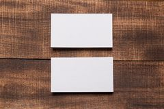 Mock up of business cards on wood background royalty free stock image