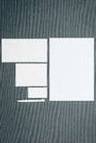 Mock-up business template with cards, papers, pen. Gray background. Stock Images