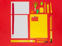 Mock-up business template with cards, papers, pen. red background. stock photography