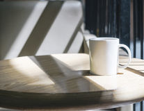 Mock up Coffee cup on table in cafe Stock Photo
