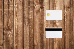 Mock-up of credit card. On wooden table Royalty Free Stock Images