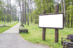 Mock up for design and advertising. Horizontal blank billboard in park Stock Photo