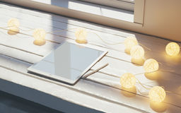 Mock-up of digital tablet on wooden table in office or home. Winter decoration, mood. 3d rendering. High quality Stock Images