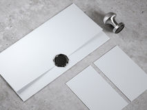 Mock up with envelope and seal stamp. Mock up with envelope and black seal stamp royalty free stock photo