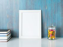Mock up frame on blue wooden wall. Copyspace, side view Stock Photography
