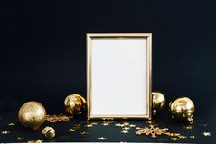 Mock up frame on dark background with Christmas decorations glitter snowflakes, baubles, bell and stars confetti. Invitation, card stock photos