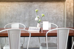 Mock up frame on table in bar restaurant cafe Royalty Free Stock Photo