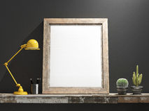Mock up Frame on Wooden table, grey wall Royalty Free Stock Photo