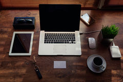 Mock up of freelance desktop with accessories and distance work tools, blank screen laptop computer and digital tablet Royalty Free Stock Photos