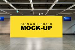 Mock up large billboard on the wall at hallway. Mock up front view the large horizontal advertising billboard with clipping path on the wall at hallway near royalty free stock photo