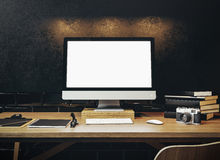 Mock up of generic design computer screen on the table. Workspac Royalty Free Stock Images