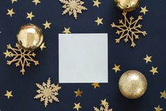 Mock up greeting card on black background with Christmas decorations ornaments glitter snowflakes, baubles and gold stars confetti Royalty Free Stock Photo