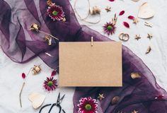 Mock up Kraft card with flowers on linen stock images
