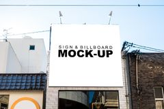 Mock up large billboard over entrance the market. The mock up signboard outside building with clipping path, blank white space of billboard for outdoor royalty free stock image