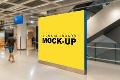 Mock up large blank billboard near the escalator. Mock up large blank yellow screen billboard with clipping path placed near the escalator in building and stock photo