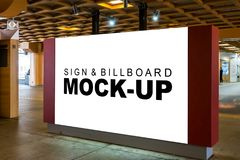 The mock up large signboard at the hall. The mock up a large indoor signboard with clipping path, blank white space for advertising or information at the hall royalty free stock photo