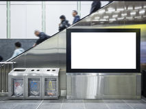 Mock up Lcd screen Public building with people on escalator Stock Images