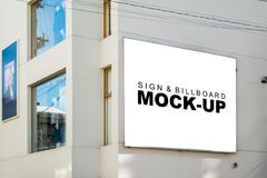 Mock up the light box billboard outside building. The Mock up the light box billboard outside building with clipping path, blank space white screen of signboard royalty free stock photos