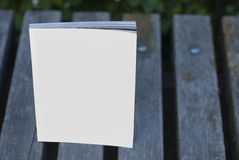 Mock-up magazines and catalogs on the bench. Royalty Free Stock Photos