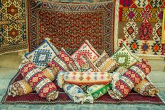Mock up of Many precious ancient colored wool Azeri carpets and ancient pillows made by hand Stock Image