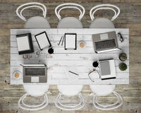 Mock up meeting conference table with office accessories and laptop computers, hipster interior background,. 3D render stock photo