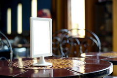 Mock up menu frame stand on table Royalty Free Stock Photography