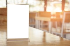 Mock up Menu frame standing on wood table in Bar restaurant cafe Stock Photography