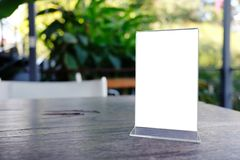 Mock up Menu frame standing on wood table in Bar restaurant cafe Stock Photos