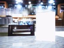 Mock up Menu frame on Table in Bar Restaurant background Royalty Free Stock Images