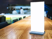 Mock up Menu frame on Table Blurred Bar restaurant with Bartende Stock Photos