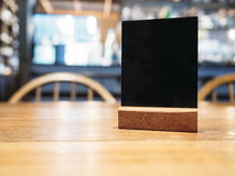 Mock up Menu frame on Table in Restaurant Cafe Background Stock Photo