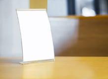Mock up Menu frame on Table in restaurant cafe Stock Image